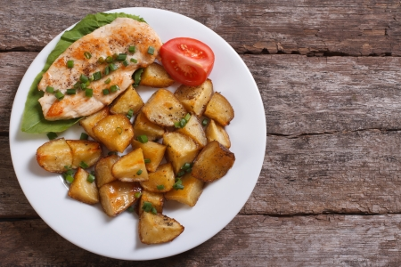 grilled chicken steak with potatoes and vegetables  top view photo