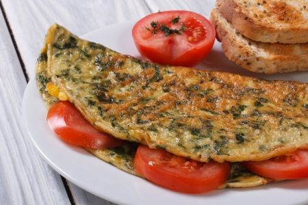 An omelet with spinach and tomatoes  Healthy and tasty breakfast