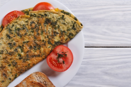 omelet with spinach and tomatoes  top view photo