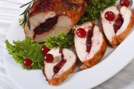 Festive food  Gently meat with cranberries and rosemary photo