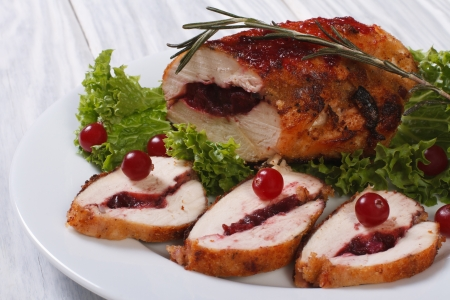 Chicken breast stuffed with cranberries with sauce photo