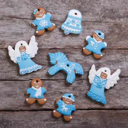 Festive gingerbread cookies on wooden table background photo
