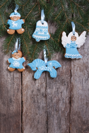 festive gingerbread cookie on a Christmas tree  vertical photo