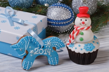 Christmas decor  muffin snowman and gingerbread horse photo