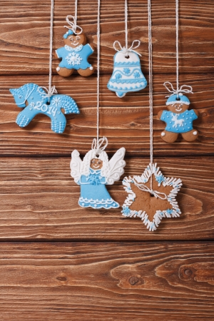 Christmas gingerbread hanging on the ropes  vertical photo