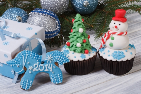 Christmas cake and symbol 2014 blue horse Stock Photo - 24037446