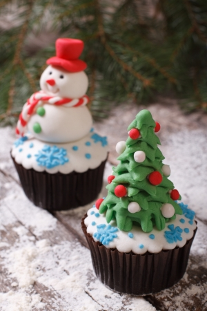 Cupcake Christmas tree on background with snowman Stock Photo - 24037617