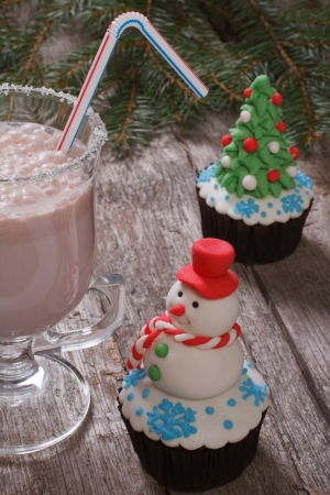 Christmas cupcakes and milkshakes on a wooden table photo