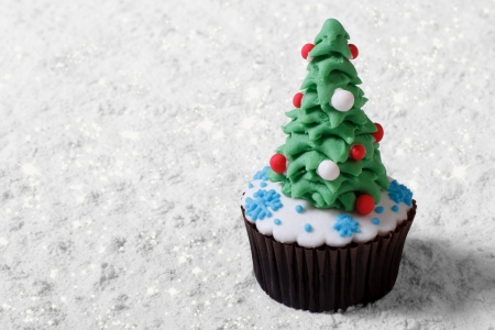 Cupcake Christmas tree on white snow  Merry Christmas Stock Photo - 24038307
