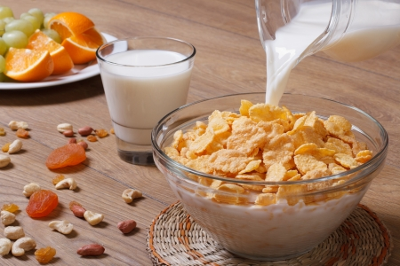 Milk being shed on corn flakes  photo
