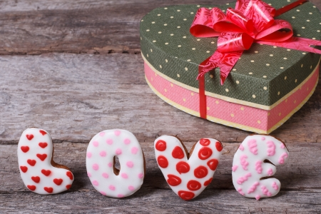 Box with a bow in the form of heart and inscription love of cookies photo