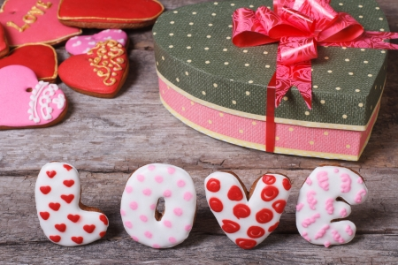 Sweet arrangement Valentine s Day  The word love and heart of cookies on the table  photo