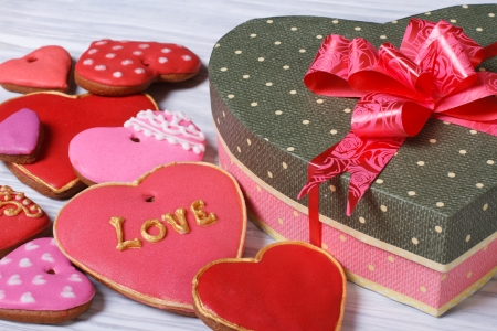 Festive box with a bow and colorful biscuit hearts for Valentine s Day Stock Photo
