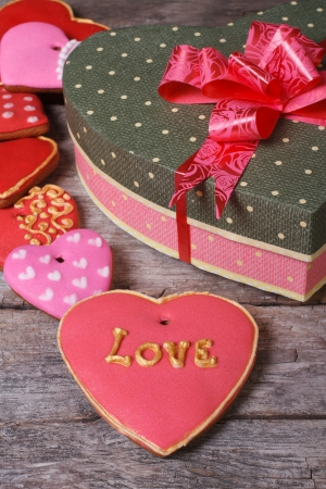 Beautiful box of heart and a lot of colorful holiday cookies Valentine s Day  vertical photo