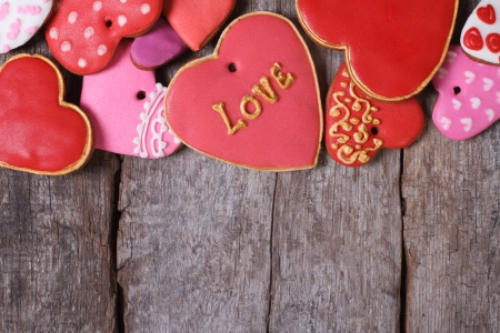 Many different hearts valentines cookies on old wooden table
