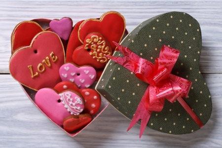 Colorful hearts biscuits in festive box top view Stock Photo
