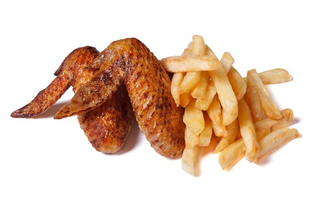 Two fried chicken wings with a crispy crust and french fries isolated on white background  photo