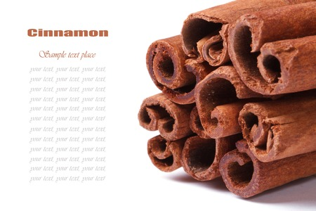 christmas scent: Bundle of cinnamon sticks closeup isolated on white background with text Stock Photo