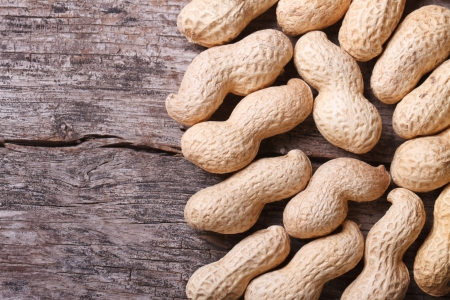 hulled: peanuts in shell closeup on a wooden table  Stock Photo
