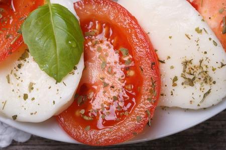 Italian caprese salad with mozzarella, basil and tomatoes. macro. horizontal