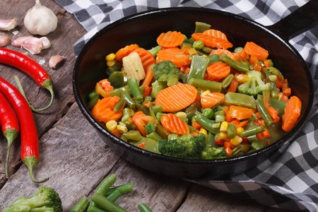 steamed vegetables in a pan on the table. horizontal. close-up  photo