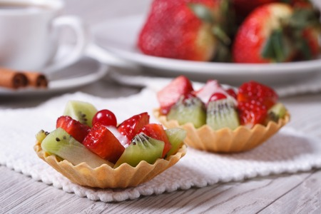 fruit tartlets with strawberries and kiwi on the table closeup   photo