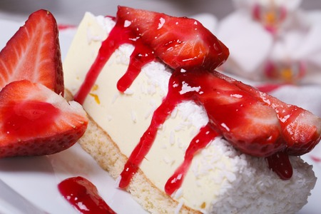 delicious cheesecake with fresh strawberries and coconut. closeup. horizontal. side view  photo