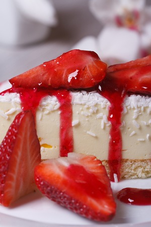 delicate dessert cheesecake with fresh strawberries and coconut. closeup. vertical. side view, macro  photo