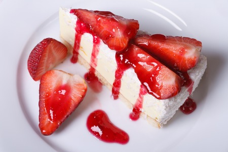 delicate dessert cheesecake with fresh strawberries closeup. horizontal. view from above.  photo