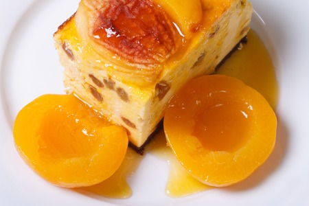 cheese casserole with raisins and peaches on a white plate top view close-up horizontal   photo