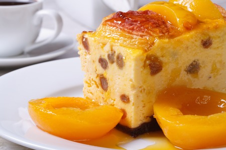 cheese casserole with raisins and peaches on a white plate closeup horizontal   photo