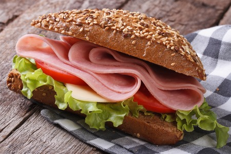 Sandwich with ham, lettuce and tomatoes on an old table. horizontal  Stock fotó