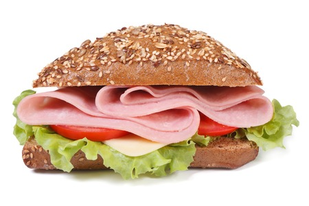 sandwich with ham, cheese, tomatoes and lettuce, sprinkling sesame seeds isolated on white background close-up.  photo