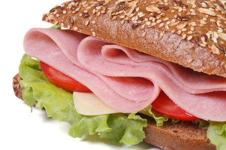 macro sandwich with ham, cheese, tomatoes and lettuce, sprinkling sesame seeds isolated on white background close-up.  photo