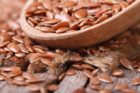 Flax seed close up in a wooden spoon horizontal  photo