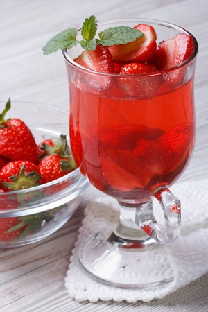 Delicious strawberry fragrant drink on the table closeup vertical  photo