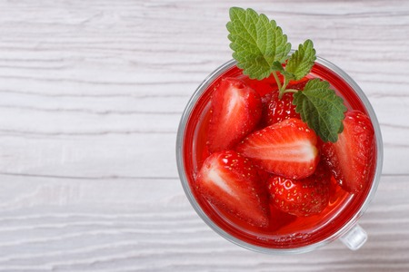 Delicious fresh strawberry drink with mint close up on the table top view   photo