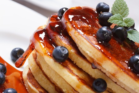 Pancake delicious with fresh blueberries, mint and maple syrup macro. horizontal  Stock Photo