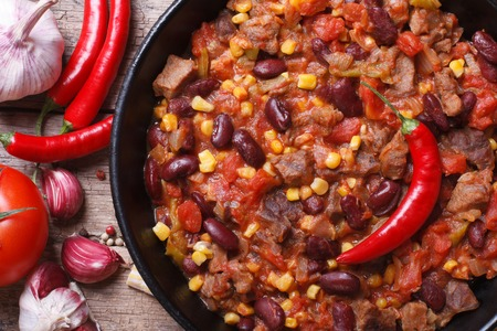 Mexican food chili con carne macro and ingredients. horizontal top view   photo
