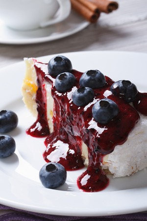 Cake with blueberries on white plate closeup and coffee on the table c  photo