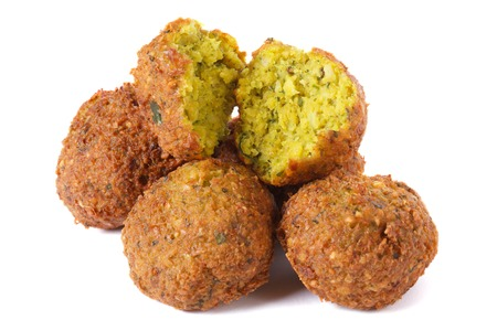 vegan food: whole and half falafel isolated on a white background closeup   Stock Photo