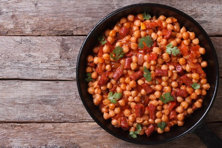beans soup: Chickpeas with chorizo in a pan close-up horizontal view from the top