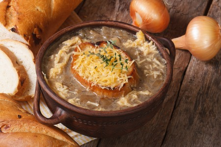 French onion soup with croutons and cheese close-up and ingredients. horizontal
