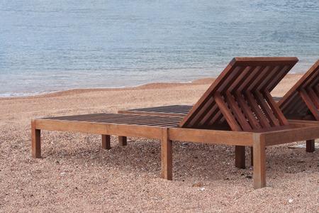 Wooden sunbeds on the beautiful beach near the sea. Montenegro photo