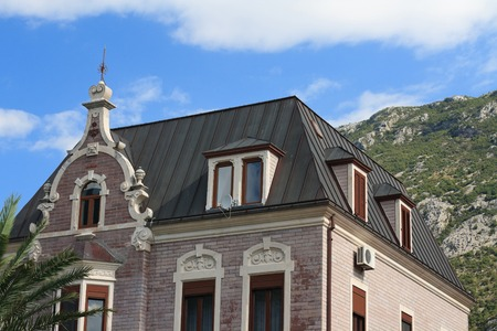 Luxury mansion on a background of mountains in Kotor, Montenegro photo