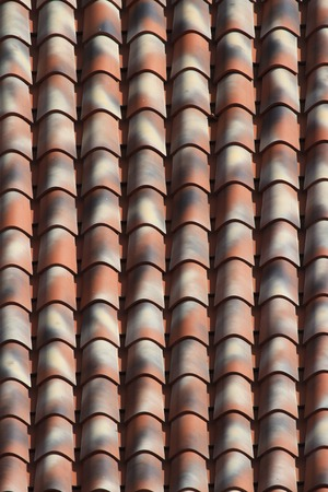 Texture speckled ceramic tile roof close up. background vertical photo