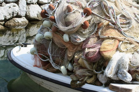 fishing net in a boat close up horizontal photo