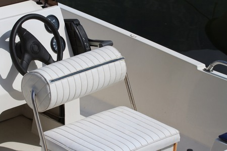 Steering wheel and dashboard of the yacht. Place seat captain. close-up photo