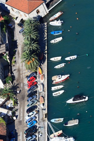 Promenade and parking in the town of Kotor which from aerial view. Montenegro photo