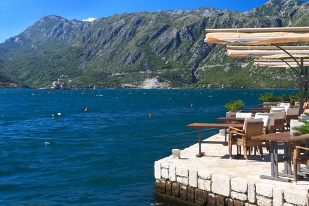 Street cafe in the town of Perast with views of the Bay of Kotor. Montenegro photo
